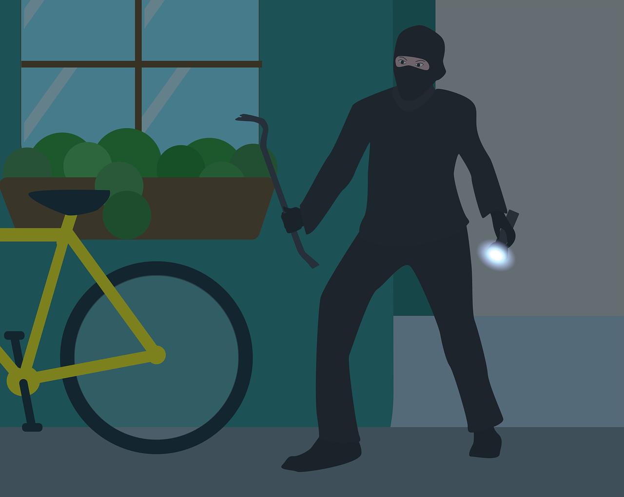 تصویر کارتونی یک دزد مشغول سرقت از خانه